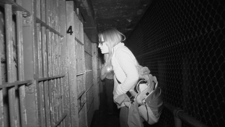 Maureen stares into a cell
